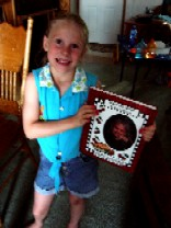 Ari, our oldest granddaughter and her hardbound children's recipe cookbook from RealBooks-Scrapbooks.com.